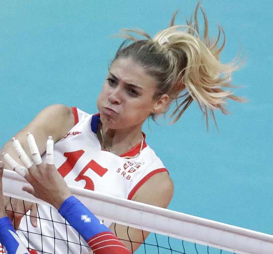 "<div class=""meta image-caption""><div class=""origin-logo origin-image ap""><span>AP</span></div><span class=""caption-text"">Serbia's Jovana Stevanovic spikes the ball (AP Photo/Jeff Roberson)</span></div>"
