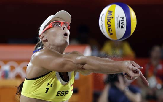 "<div class=""meta image-caption""><div class=""origin-logo origin-image ap""><span>AP</span></div><span class=""caption-text"">Spain's Liliana Fernandez sets up the ball during a volleyball match (AP Photo/Marcio Jose Sanchez)</span></div>"