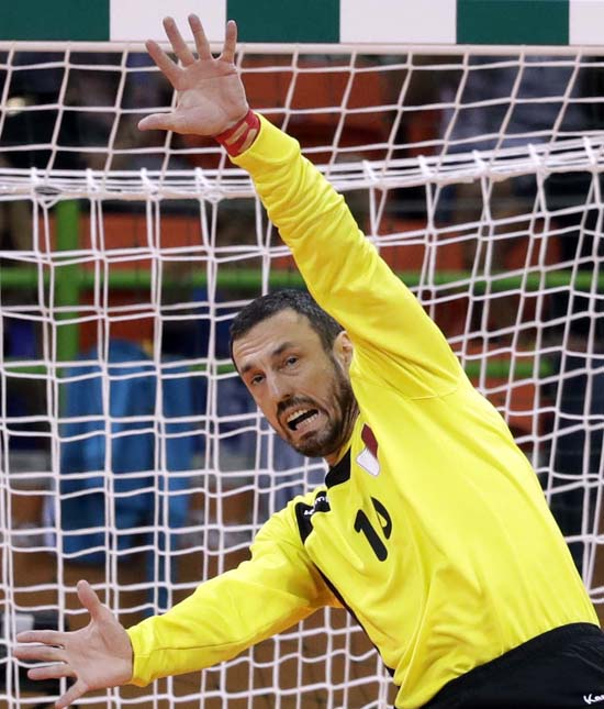 "<div class=""meta image-caption""><div class=""origin-logo origin-image ap""><span>AP</span></div><span class=""caption-text"">France's Cedric Sorhaindo scores a goal past Qatar's Goran Stojanovic during the men's preliminary handball match (AP Photo/Ben Curtis)</span></div>"