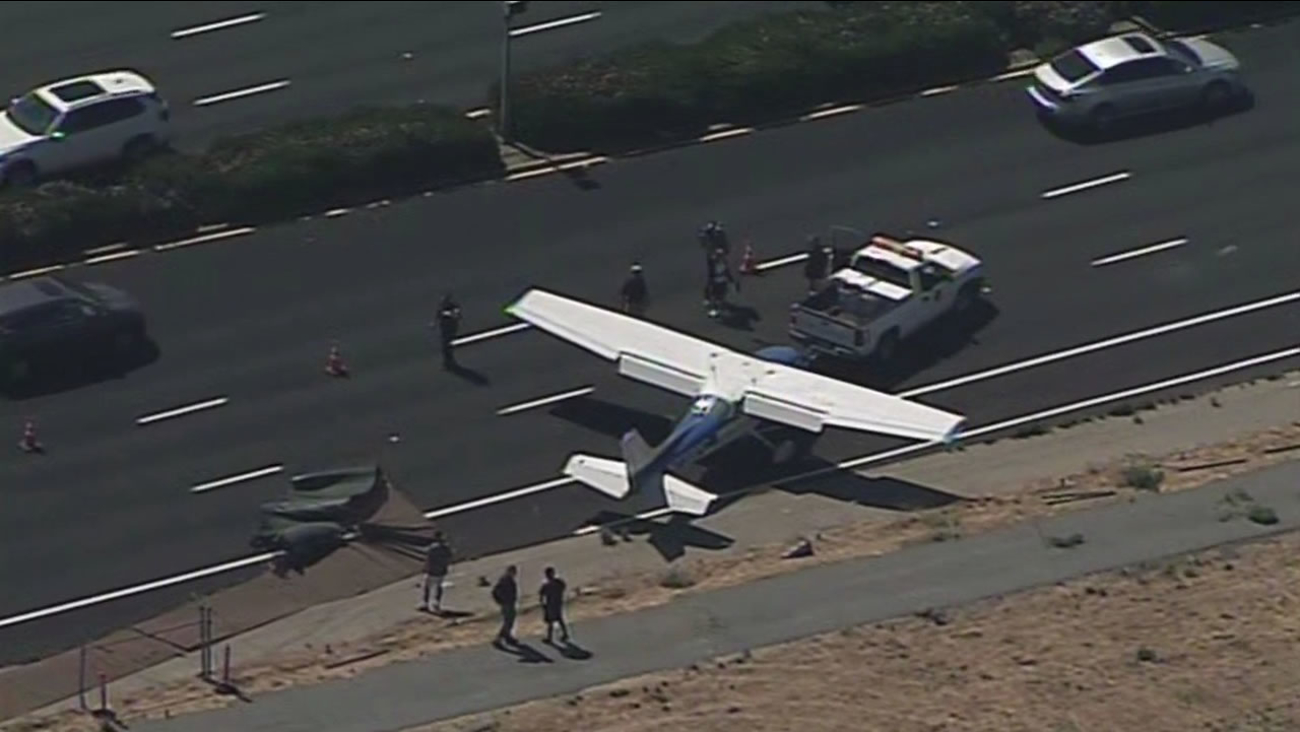 This image shows a plane in San Jose's Tully Road after it went through an airport fence August 10, 2016.