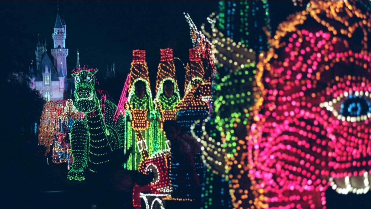 In this Nov. 25, 1996, file photo, the Main Street Electrical Parade moves down Main Street in Disneyland, in Anaheim, Calif.