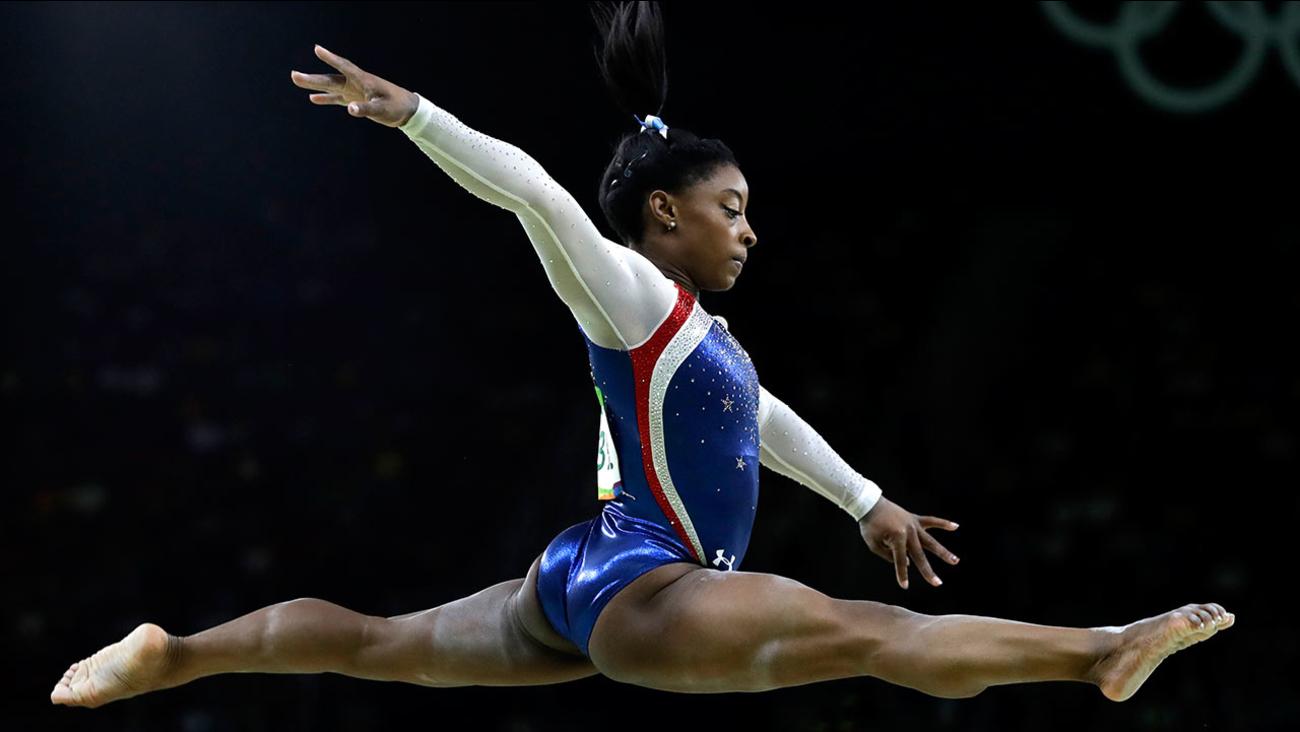 United States' Simone Biles performs on the balance beam
