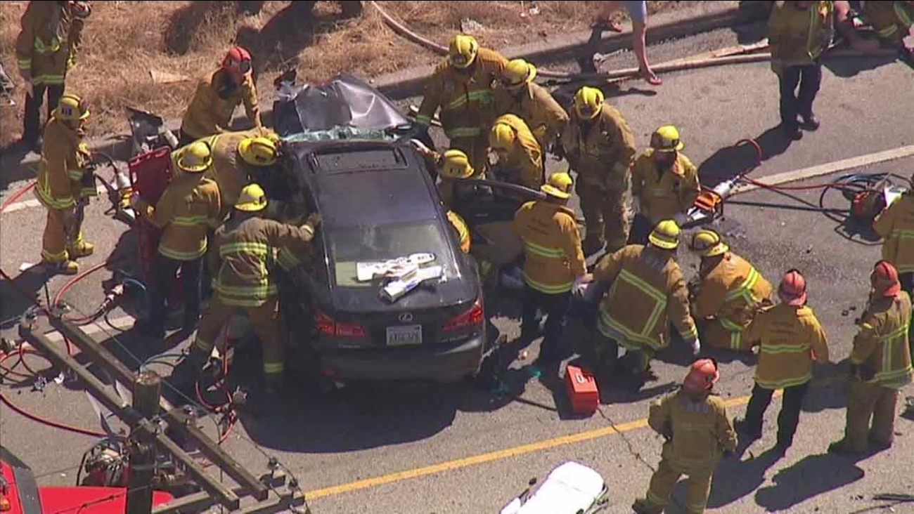 Firefighters help rescue several people from a deadly multi-vehicle crash in Sunland on Friday, Aug. 12, 2016.