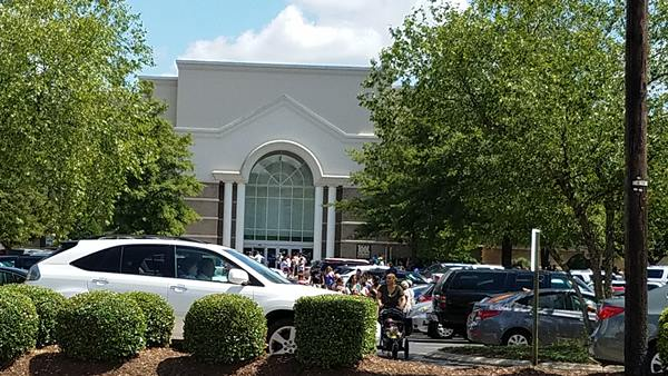 <div class='meta'><div class='origin-logo' data-origin='WTVD'></div><span class='caption-text' data-credit='Eyewitness photo'>Pictures from the scene at Crabtree Valley Mall after reports of shots fired</span></div>