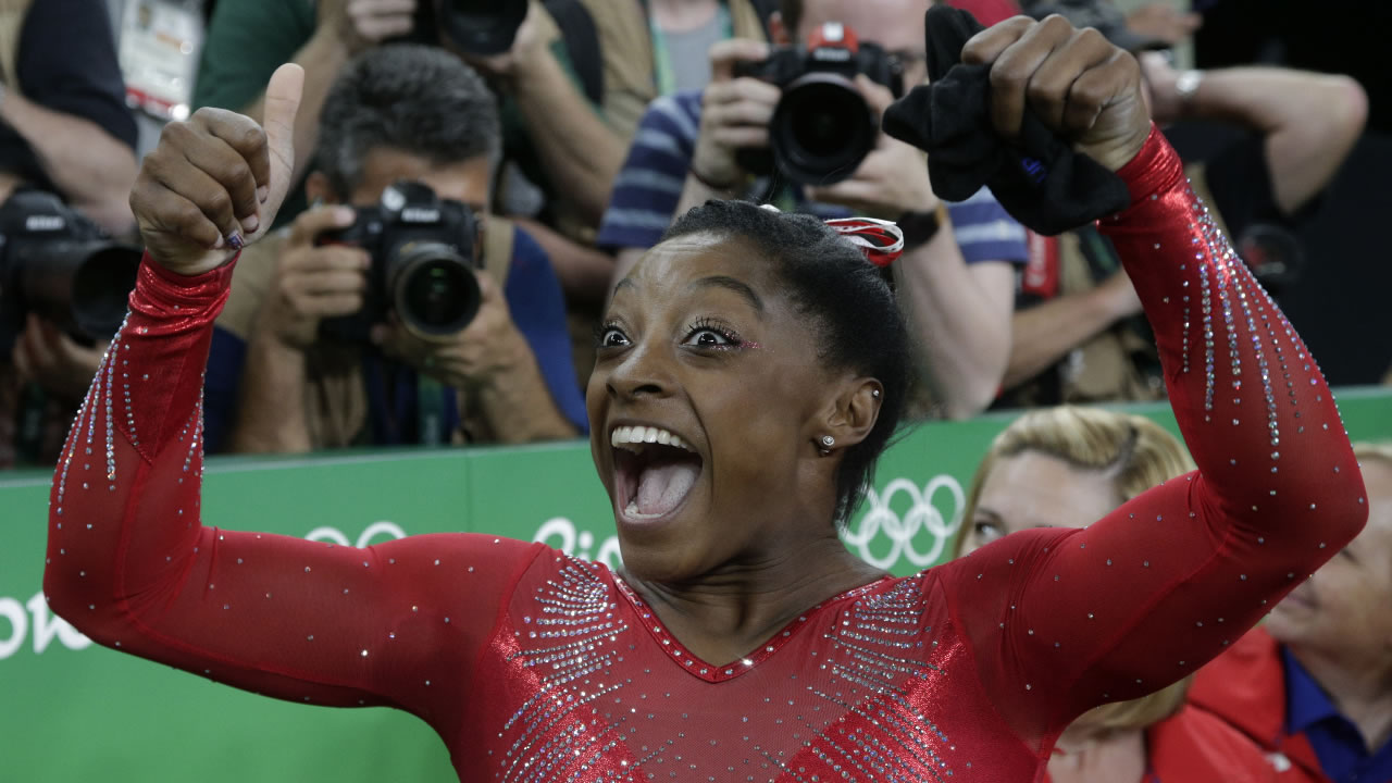 United States' Simone Biles celebrates after her winning gold in the vault during the artistic gymnastics women's apparatus final at the 2016 Summer Olympics in Rio de Janeiro, Brazil, Sunday, Aug. 14, 2016.