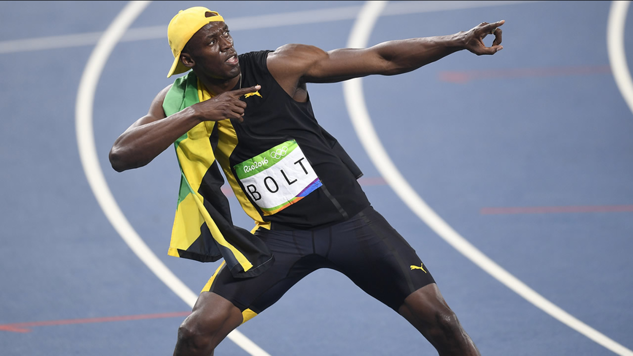 Jamaica's Usain Bolt celebrates winning the men's 100-meter final during the athletics competitions of the 2016 Summer Olympics at the Olympic stadium in Rio de Janeiro, Brazil, Sunday, Aug. 14, 2016. (AP Photo/Martin Meissner)