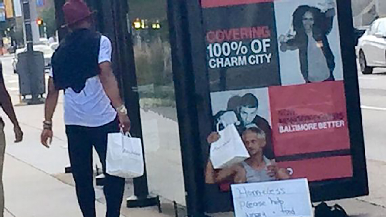 Cam Newton giving food to the homeless the night before last week's preseason opener in Baltimore.
