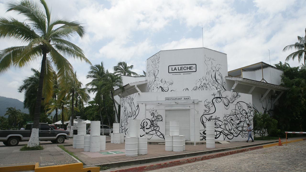 "The entrance of the restaurant ""La Leche"" stands closed after armed men abducted as many as 16 people who were dining in the upscale restaurant in Puerto Vallarta"