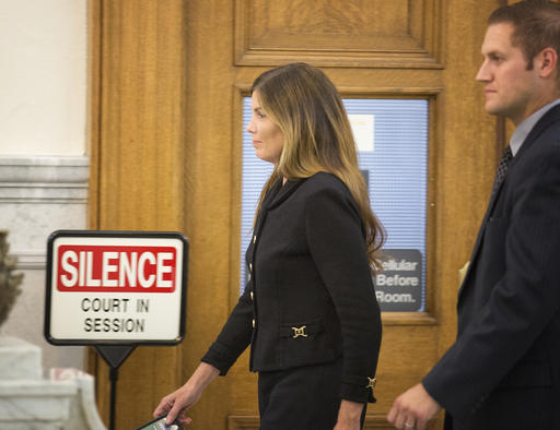 <div class='meta'><div class='origin-logo' data-origin='AP'></div><span class='caption-text' data-credit='AP'>Pennsylvania Attorney General Kathleen Kane, escorted by a member of her security team, prepares to leave the Montgomery County Courthouse and await a verdict.</span></div>