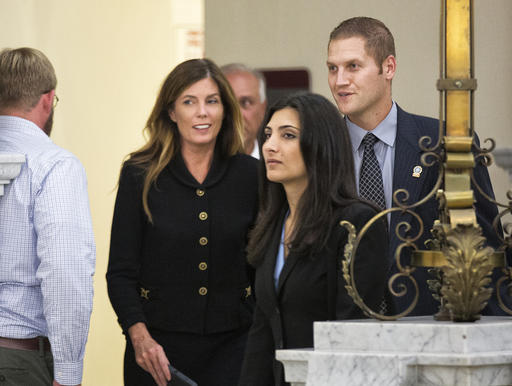<div class='meta'><div class='origin-logo' data-origin='AP'></div><span class='caption-text' data-credit='AP'>Pennsylvania Attorney General Kathleen Kane, second left, and members of her legal and security teams, prepare to leave the Montgomery County Courthouse and await a verdict.</span></div>
