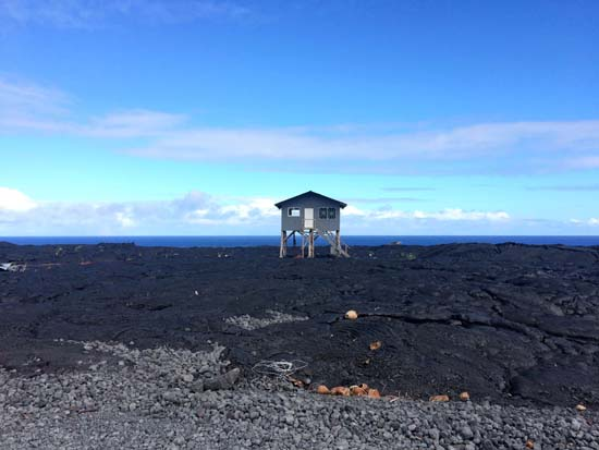 """<div class=""""meta image-caption""""><div class=""""origin-logo origin-image ap""""><span>AP</span></div><span class=""""caption-text"""">A small home sits on private property atop a former lava flow from Kilauea (AP Photo/Caleb Jones))</span></div>"""