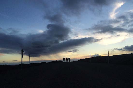 """<div class=""""meta image-caption""""><div class=""""origin-logo origin-image ap""""><span>AP</span></div><span class=""""caption-text"""">Visitors hike along a gravel access road to get to a lava flow from Kilauea, an active volcano on Hawaii's Big Island, in Volcanoes National Park (AP Photo/Caleb Jones)</span></div>"""