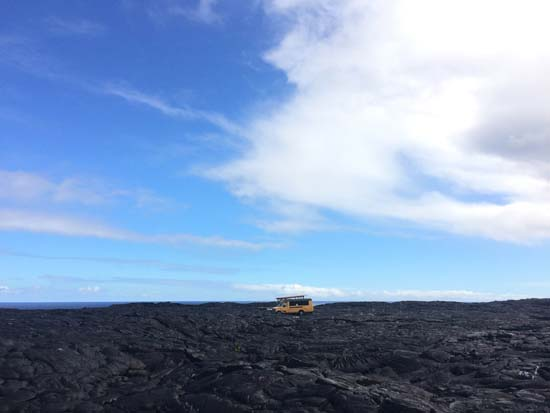 """<div class=""""meta image-caption""""><div class=""""origin-logo origin-image ap""""><span>AP</span></div><span class=""""caption-text"""">A school bus being used as a homestead sits on private property atop a former lava flow from Kilauea (AP Photo/Caleb Jones)</span></div>"""