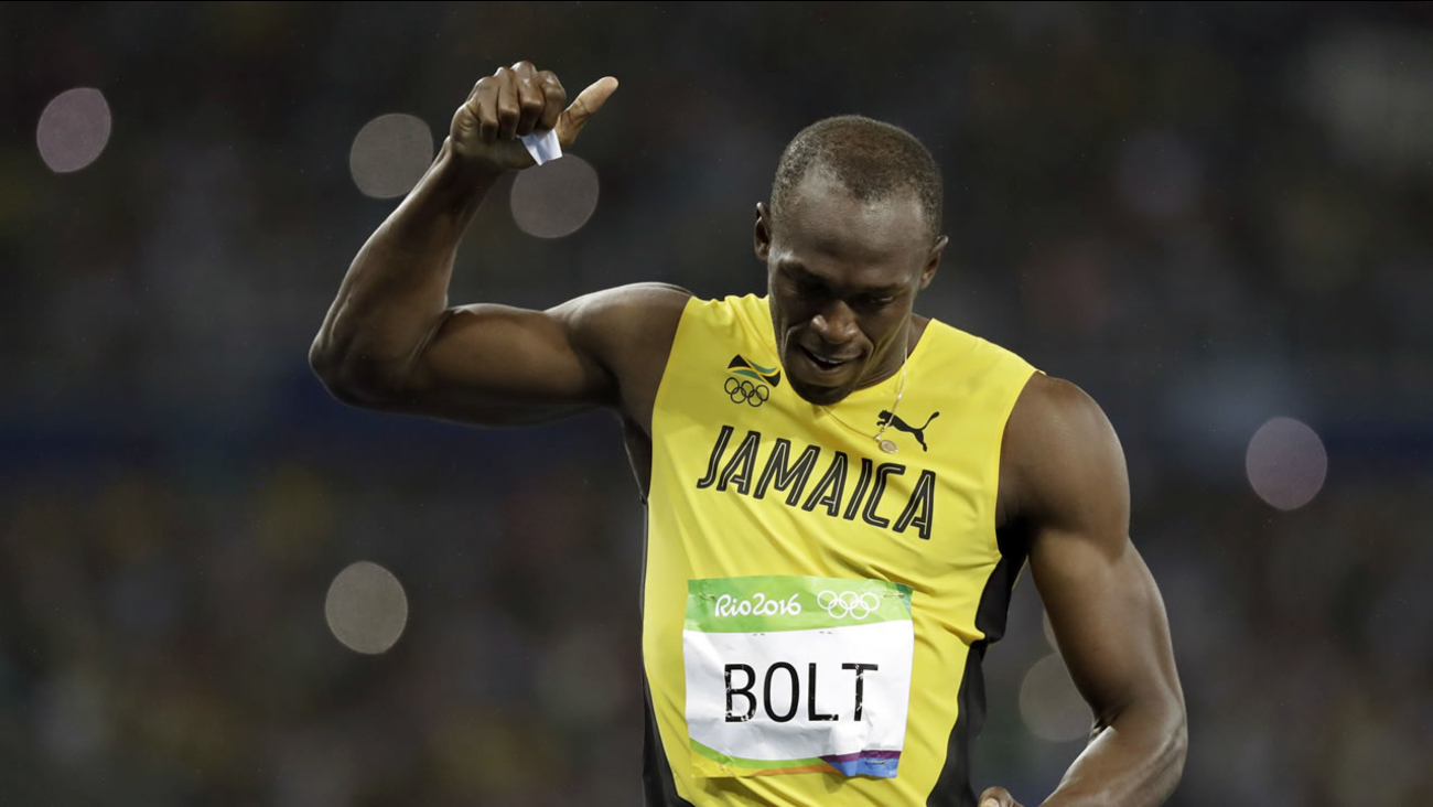 Usain Bolt from Jamaica celebrates winning the gold medal in the men's 200-meter final during the athletics competitions of the 2016 Summer Olympics on August 18, 2016.