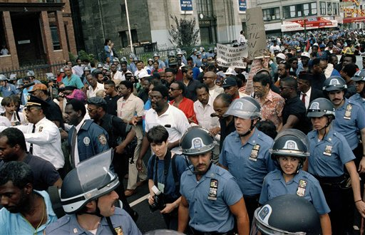 """<div class=""""meta image-caption""""><div class=""""origin-logo origin-image none""""><span>none</span></div><span class=""""caption-text"""">Hundreds of protesters, escorted by police, march towards Lubovitcher Synagogue in the Crown Heights section of Brooklyn, New York, Aug. 24, 1991. (AP Photo/Joe Major)</span></div>"""