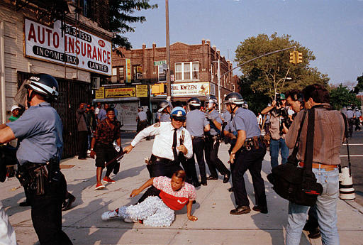"<div class=""meta image-caption""><div class=""origin-logo origin-image none""><span>none</span></div><span class=""caption-text"">New York City police scuffle with a protester during a march through the Crown Heights section of Brooklyn, Aug. 21, 1991. (AP Photo/Joe Major)</span></div>"