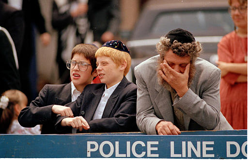 """<div class=""""meta image-caption""""><div class=""""origin-logo origin-image none""""><span>none</span></div><span class=""""caption-text"""">Orthodox Jews react as a crowd of angry black demonstrators approach the Lubavitcher Synagogue in the Crown Heights section of Brooklyn, N.Y., Aug. 25, 1991. (AP Photo/Mark Lennihan)</span></div>"""
