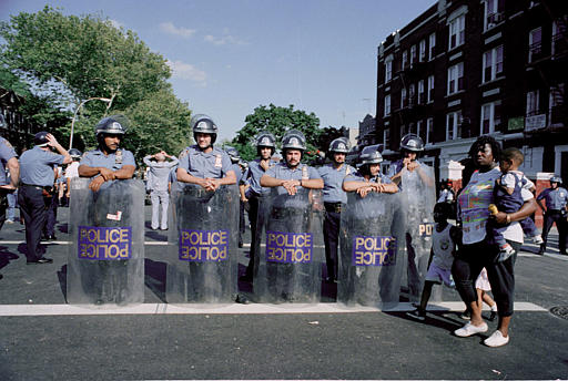 """<div class=""""meta image-caption""""><div class=""""origin-logo origin-image none""""><span>none</span></div><span class=""""caption-text"""">A group of police in full riot gear make up part of the massive police presence which temporarily quelled the Brooklyn, N.Y., Crown Heights neighborhood riots, Aug. 23, 1991. (AP Photo/David Cantor)</span></div>"""