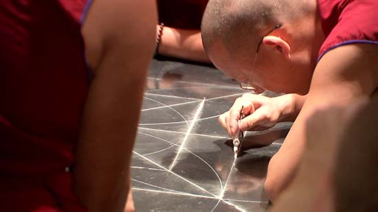 """<div class=""""meta image-caption""""><div class=""""origin-logo origin-image ktrk""""><span>KTRK</span></div><span class=""""caption-text"""">Drepung Loseling monks sketch the outline of their sand mandala, to be created this week at the Asia Society Texas Center (KTRK)</span></div>"""