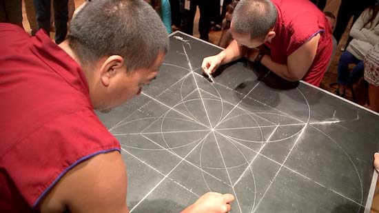 """<div class=""""meta image-caption""""><div class=""""origin-logo origin-image ktrk""""><span>KTRK</span></div><span class=""""caption-text"""">Drepung Loseling monks form the outline of their sand mandala, to be created this week at the Asia Society Texas Center</span></div>"""