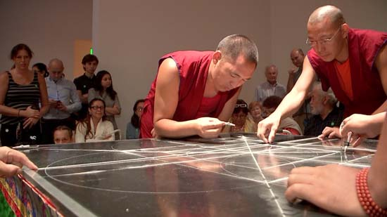 <div class='meta'><div class='origin-logo' data-origin='KTRK'></div><span class='caption-text' data-credit=''>Drepung Loseling monks form the outline of their sand mandala, to be created this week at the Asia Society Texas Center</span></div>