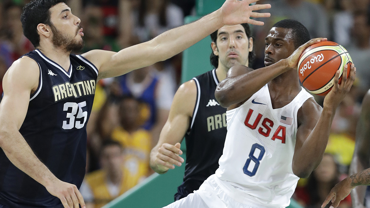 United States' Harrison Barnes (8) grabs a rebound over Argentina's Roberto Acuna (35) during a quarterfinal round basketball game at the 2016 Summer Olympics in Rio de Janeiro