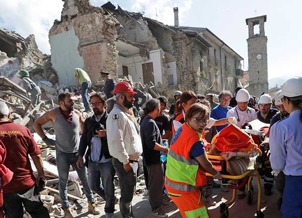 "<div class=""meta image-caption""><div class=""origin-logo origin-image none""><span>none</span></div><span class=""caption-text"">A victim is pulled out of the rubble following an earthquake in Amatrice Italy, Wednesday, Aug. 24, 2016. (Alessandra Tarantino/AP Photo)</span></div>"