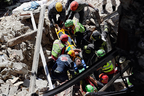 <div class='meta'><div class='origin-logo' data-origin='none'></div><span class='caption-text' data-credit='Andrew Medichini/AP Photo'>A man is rescued from the rubble of a building after an earthquake, in Accumoli, central Italy, Wednesday, Aug. 24, 2016</span></div>