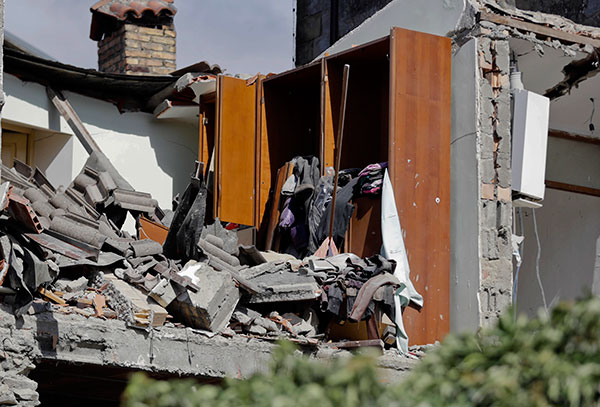 <div class='meta'><div class='origin-logo' data-origin='none'></div><span class='caption-text' data-credit='Andrew Medichini/AP Photo'>What remains of an house interior is covered with rubble following an earthquake in Accumuli, central Italy, Wednesday, Aug. 24, 2016.</span></div>