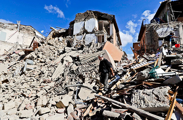"<div class=""meta image-caption""><div class=""origin-logo origin-image none""><span>none</span></div><span class=""caption-text"">A man walks amid rubbles after an earthquake struck in Amatrice Italy, Wednesday, Aug. 24, 2016. (Alessandra Tarantino/AP Photo)</span></div>"