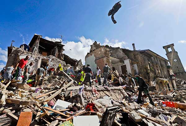 <div class='meta'><div class='origin-logo' data-origin='none'></div><span class='caption-text' data-credit='Alessandra Tarantino/AP Photo'>Rescuers search amid rubble following an earthquake in Amatrice Italy, Wednesday, Aug. 24, 2016.</span></div>