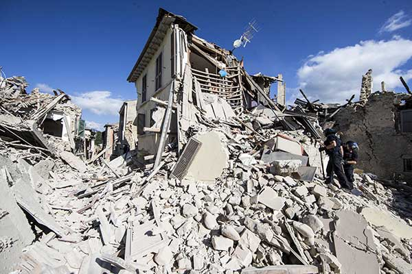 "<div class=""meta image-caption""><div class=""origin-logo origin-image none""><span>none</span></div><span class=""caption-text"">Rescuers search for survivors under the rubble of the town of Amatrice, central Italy, Wednesday, Aug. 24, 2016 following an earthquake. (Massimo Percossi/ANSA via AP)</span></div>"