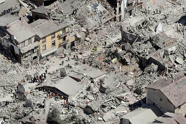 <div class='meta'><div class='origin-logo' data-origin='none'></div><span class='caption-text' data-credit='Gregorio Borgia/AP Photo'>Rescuers search amid rubble following an earthquake in Amatrice Italy, Wednesday, Aug. 24, 2016.</span></div>