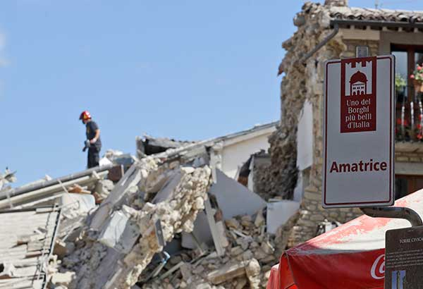<div class='meta'><div class='origin-logo' data-origin='none'></div><span class='caption-text' data-credit='Alessandra Tarantino/AP Photo'>Rescuers work in Amatrice, central Italy, Wednesday, Aug. 24, 2016, where a magnitude 6 quake struck at 3:36 a.m. (0136 GMT)</span></div>