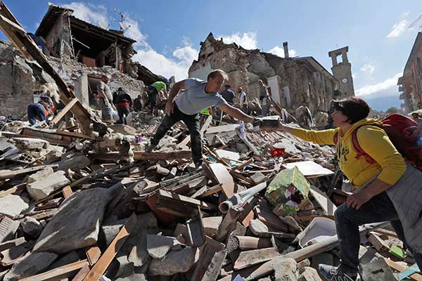 <div class='meta'><div class='origin-logo' data-origin='none'></div><span class='caption-text' data-credit='Alessandra Tarantino/AP Photo'>Rescuers search for survivors under the rubble of the town of Amatrice, central Italy, Wednesday, Aug. 24, 2016</span></div>