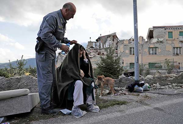 "<div class=""meta image-caption""><div class=""origin-logo origin-image none""><span>none</span></div><span class=""caption-text"">An elderly man is given assistance as collapsed buildings are seen in the background following an earthquake, in Amatrice, Italy, Wednesday, Aug. 24, 2016. (Alessandra Tarantino/AP Photo)</span></div>"
