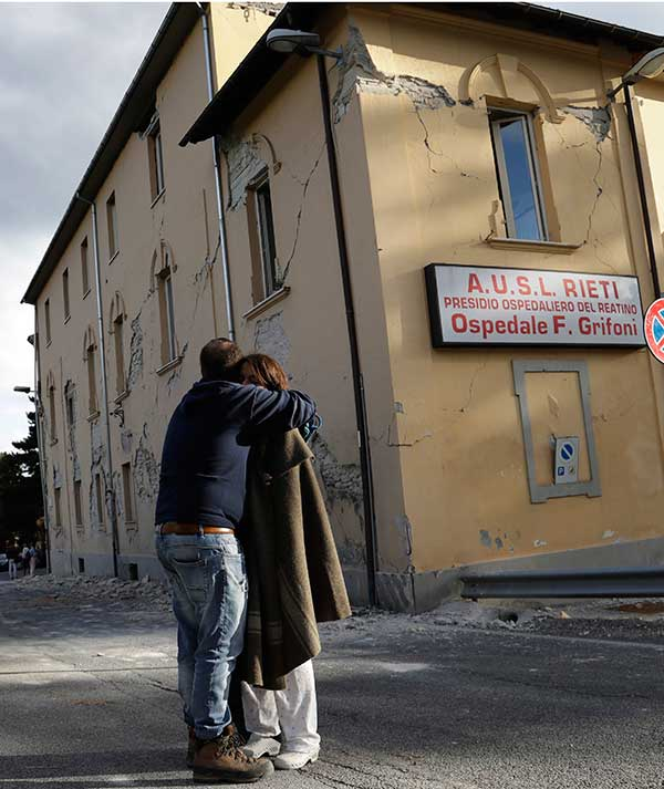 "<div class=""meta image-caption""><div class=""origin-logo origin-image none""><span>none</span></div><span class=""caption-text"">A woman is hugged outside a hospital building with visible cracks following an earthquake, in Amatrice, Italy, Wednesday, Aug. 24, 2016. (Alessandra Tarantino/AP Photo)</span></div>"
