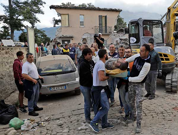 "<div class=""meta image-caption""><div class=""origin-logo origin-image none""><span>none</span></div><span class=""caption-text"">A man is carried out on a stretcher as a collapsed building is seen in the background following an earthquake, in Amatrice, Italy, Wednesday, Aug. 24, 2016. (Alessandra Tarantino/AP Photo)</span></div>"