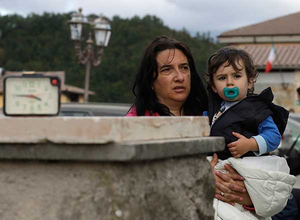 "<div class=""meta image-caption""><div class=""origin-logo origin-image none""><span>none</span></div><span class=""caption-text"">A woman and child stand in the street after an earthquake, in Amatrice, Wednesday, Aug. 24, 2016. (Alessandra Tarantino/AP Photo)</span></div>"