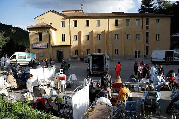 "<div class=""meta image-caption""><div class=""origin-logo origin-image none""><span>none</span></div><span class=""caption-text"">A makeshift medical camp is set up outside a hospital following an earthquake, in Amatrice, Italy, Wednesday, Aug. 24, 2016. (Alessandra Tarantino/AP Photo)</span></div>"