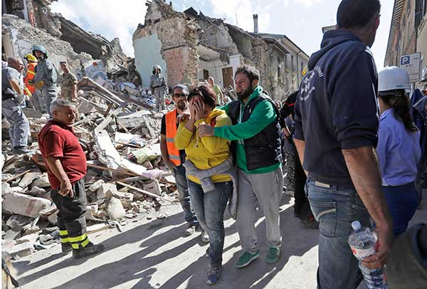 "<div class=""meta image-caption""><div class=""origin-logo origin-image none""><span>none</span></div><span class=""caption-text"">A woman is comforted as she walks through rubble after an earthquake, in Amatrice, central Italy, Wednesday, Aug. 24, 2016. (Alessandra Tarantino/AP Photo)</span></div>"