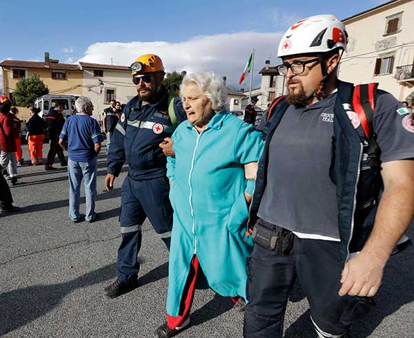 <div class='meta'><div class='origin-logo' data-origin='none'></div><span class='caption-text' data-credit='Andrew Medichini/AP Photo'>An elderly woman is escorted by rescuers following an earthquake, in Accumoli, central Italy, Wednesday, Aug. 24, 2016.</span></div>