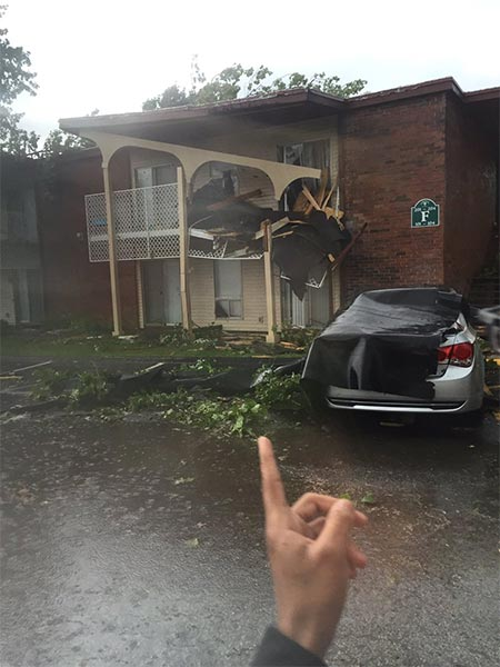 <div class='meta'><div class='origin-logo' data-origin='none'></div><span class='caption-text' data-credit='Courtesy of Aaron Baber'>Damage to an apartment complex by a tornado in Kokomo, Ind.</span></div>
