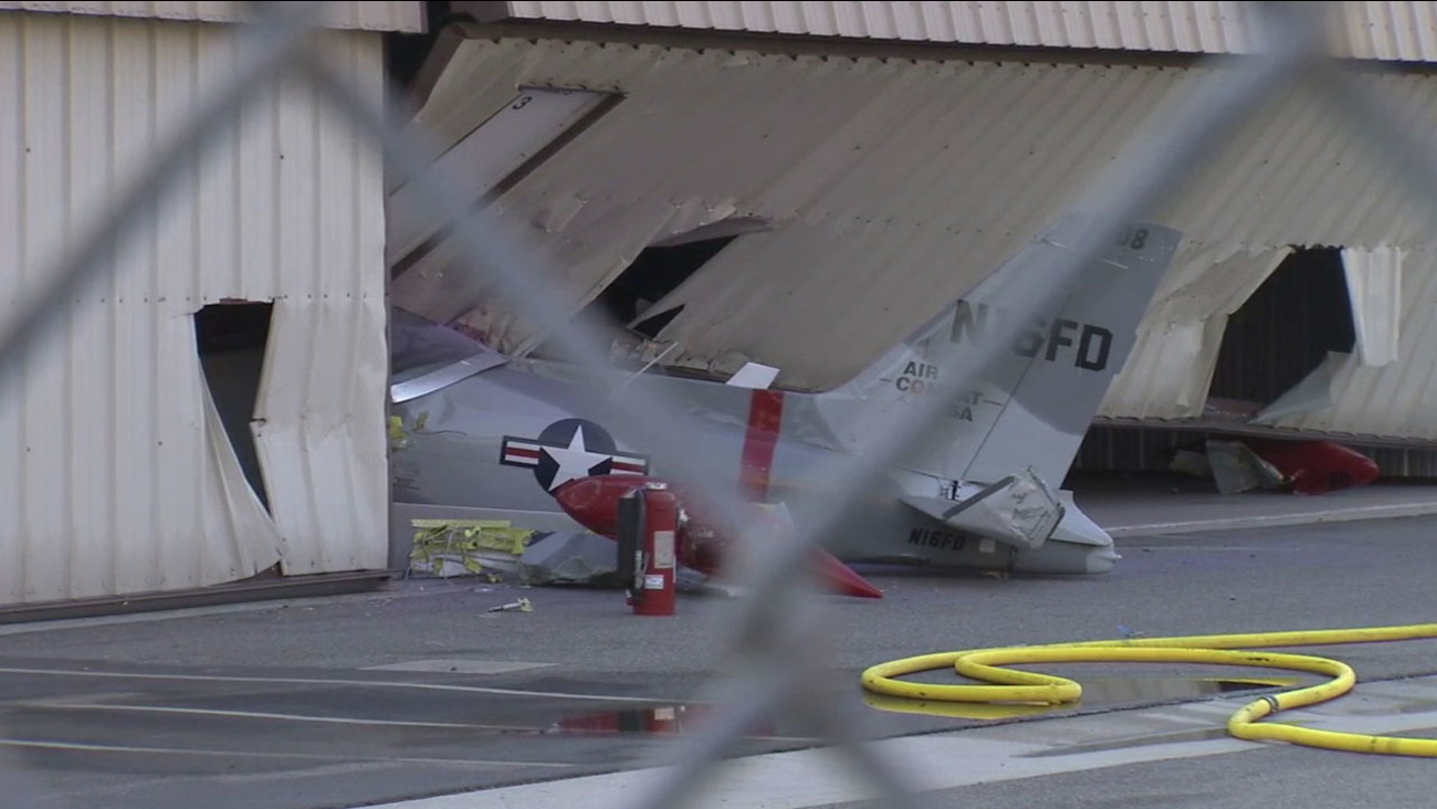A private single-engine plane crashed into a Fullerton airport hangar on Wednesday, Aug. 24, 2016.