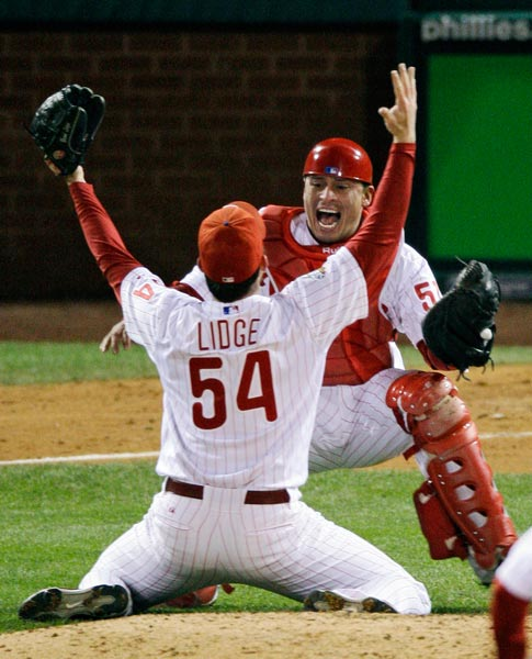 "<div class=""meta image-caption""><div class=""origin-logo origin-image ap""><span>AP</span></div><span class=""caption-text"">Philadelphia Phillies catcher Carlos Ruiz celebrates with relief pitcher Brad Lidge (54) after the final out in Game 5 of the baseball World Series in Philadelphia. (Charles Krupa)</span></div>"