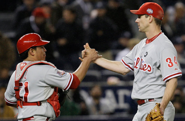 "<div class=""meta image-caption""><div class=""origin-logo origin-image ap""><span>AP</span></div><span class=""caption-text"">Philadelphia Phillies' Cliff Lee is congratulated by catcher Carlos Ruiz after defeating the New York Yankees in Game 1 of the 2009 Major League Baseball World Series. (David J. Phillip)</span></div>"