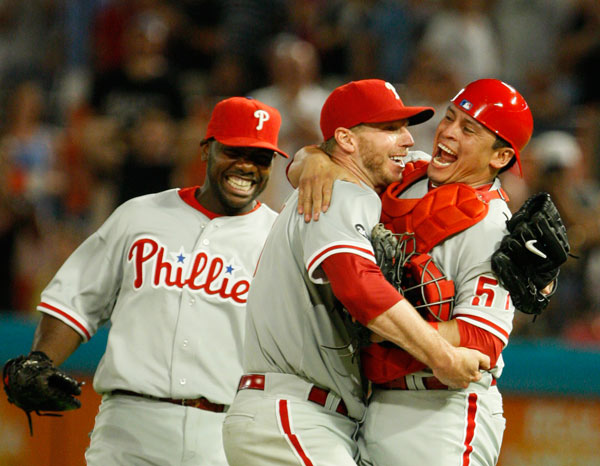 "<div class=""meta image-caption""><div class=""origin-logo origin-image ap""><span>AP</span></div><span class=""caption-text"">Philadelphia Phillies starting pitcher Roy Halladay, center, celebrates with Carlos Ruiz, right, and Ryan Howard after Halladay threw a perfect game. (Wilfredo Lee)</span></div>"
