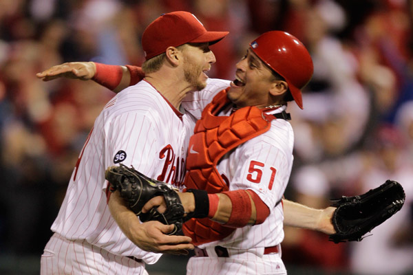 "<div class=""meta image-caption""><div class=""origin-logo origin-image ap""><span>AP</span></div><span class=""caption-text"">Philadelphia Phillies starting pitcher Roy Halladay, left, celebrates with catcher Carlos Ruiz (51) after throwing a no-hitter during Game 1 NLDS 2010. (AP Photo/Rob Carr)</span></div>"