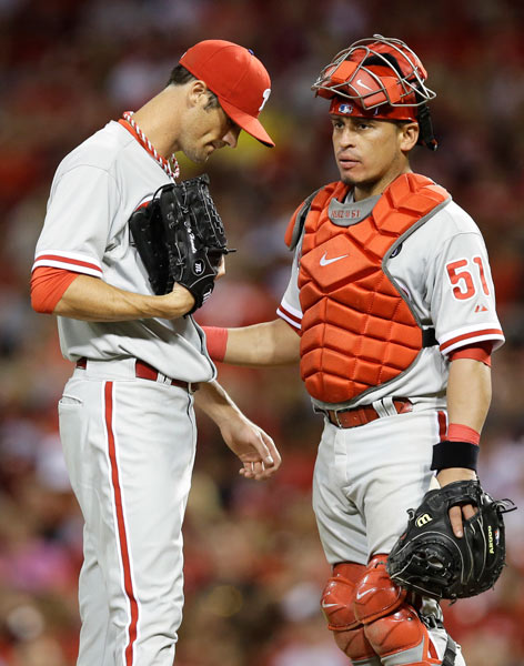 "<div class=""meta image-caption""><div class=""origin-logo origin-image ap""><span>AP</span></div><span class=""caption-text"">Philadelphia Phillies catcher Carlos Ruiz (51) talks with starting pitcher Cole Hamels in the eighth inning of a baseball game against the Cincinnati Reds, Friday, June 6, 2014. (AP Photo/Al Behrman)</span></div>"