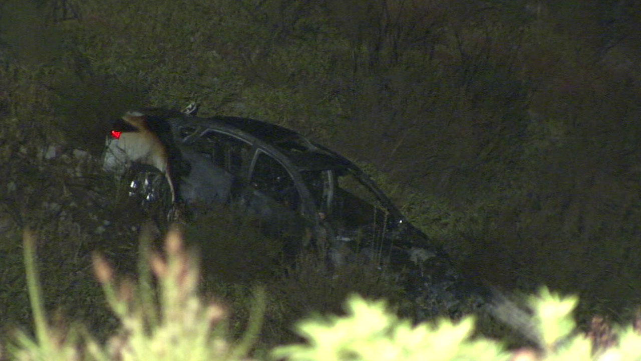 A car burst into flames after a chase suspect careened off Interstate 15 into an embankment on Friday, Aug. 16, 2016.